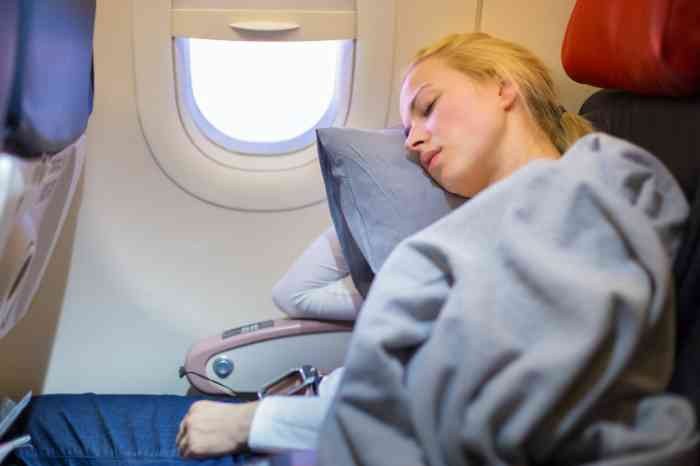 a girl sleeping in an airplane