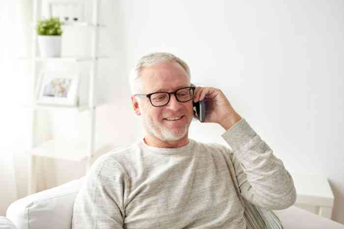 a man calling with an amplified mobile phone for hard of hearing