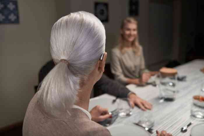woman with hearing aid at dinner table