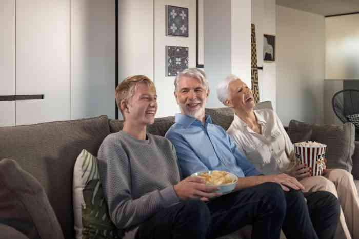 grandparents and grandson sitting on lounge