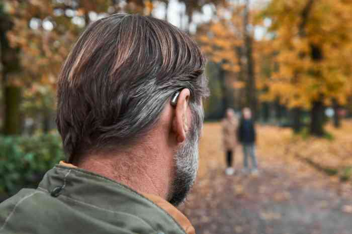 man with hearing aid at park