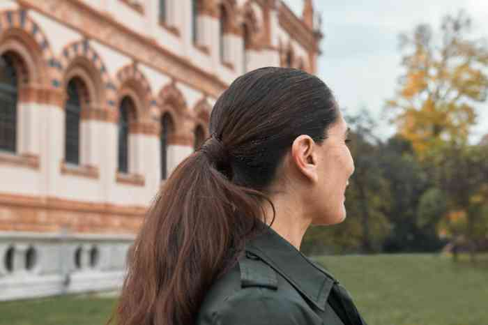 woman in park with hearing aid