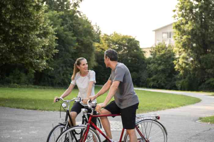 two people talking together on their bycicles