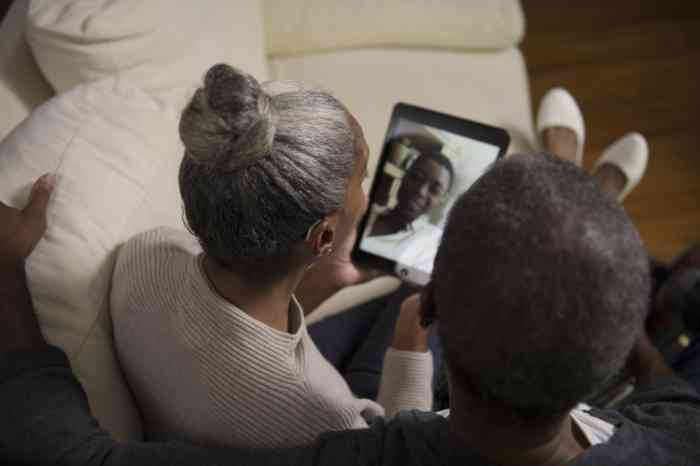 A couple listening to a facetime call straight away in their hearing aids