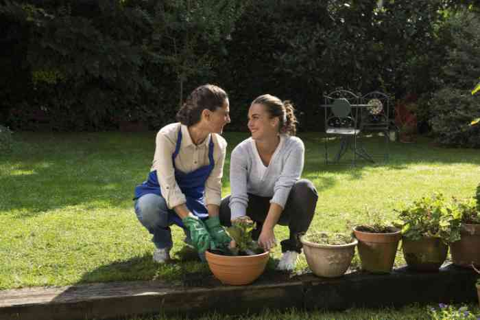 a woman wearing invisible hearing aids gardening with her daughter