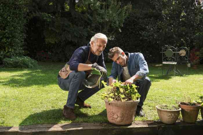 father and son gardening outside