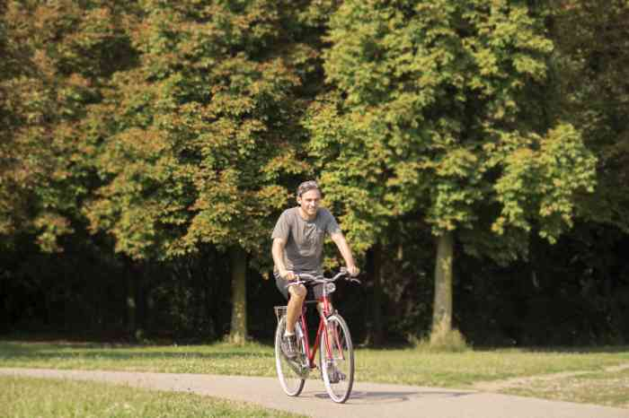 a man going cycling in a park