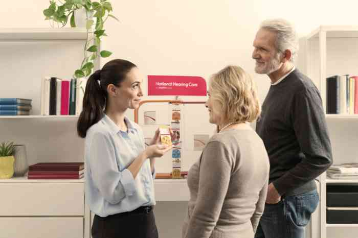 a couple speaking to an audiologist in a national hearing care center