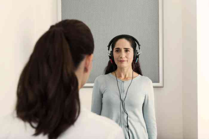 woman taking a hearing test