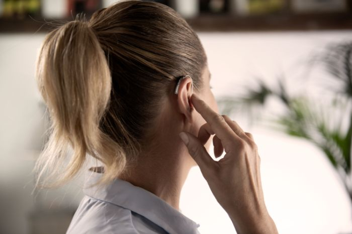 an audiologist examining the ear of a girl
