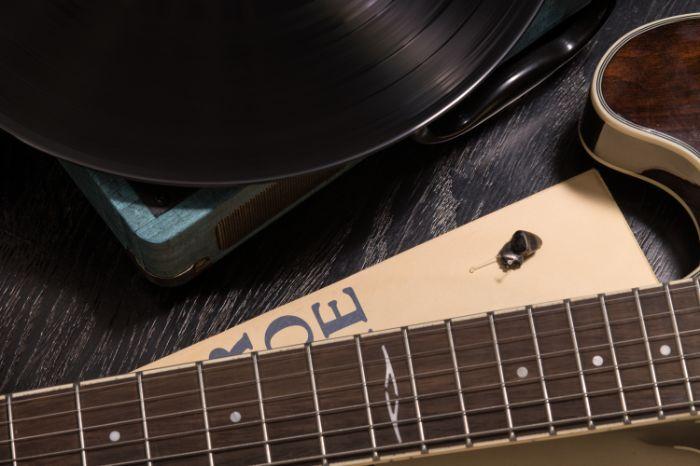a guitar and a vinyl